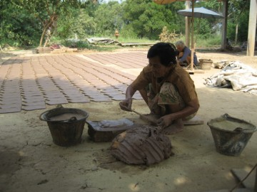 Fixing the clay on the mould and use of wooden cutter