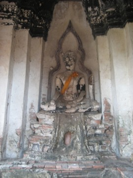 Crowned Buddha within the meru